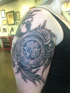 Pocket watch tattoo , black and grey tattoo st Augustine , realistic black and grey tattoo florida , tattoo artist florida, saint Augustine beach